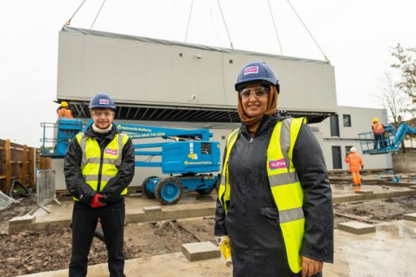 Modular homes craned into place for homeless families in Barking